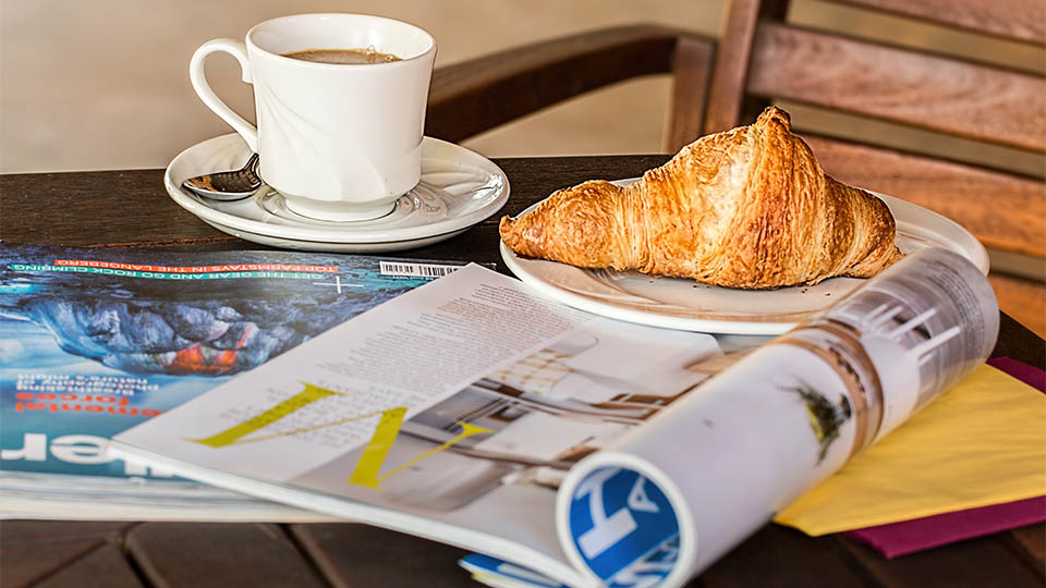 Coffee, Croissant and Magazine