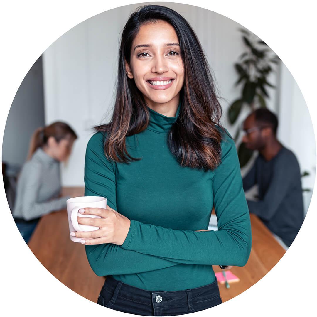 South-Asian female entrepreneur in office