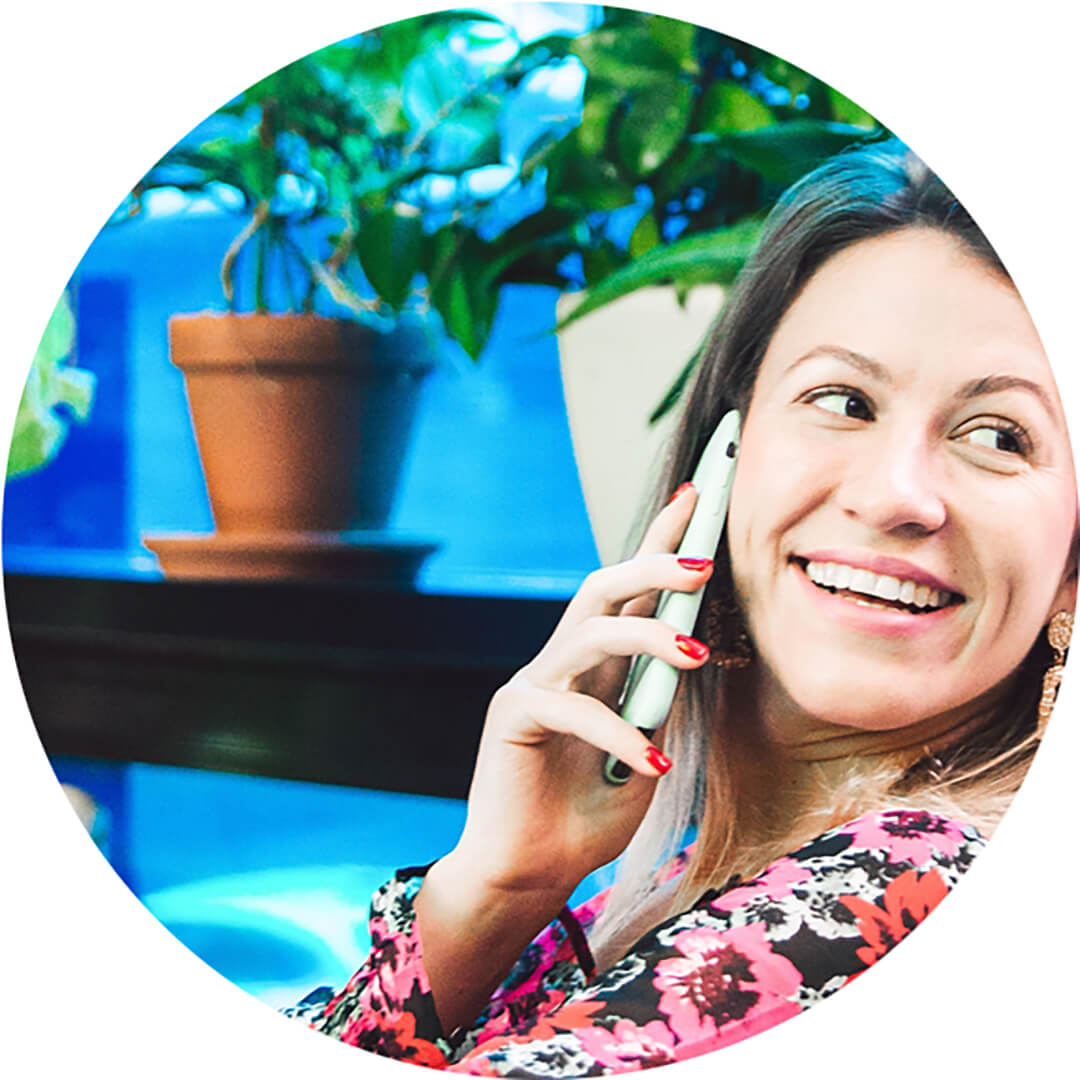 Female entrepreneur smiling and talking on the phone